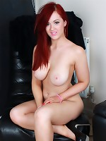 Sweet redhead takes off her dungaree dress and plays with her natural big boobs